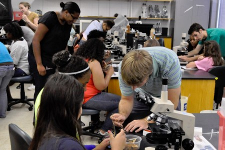 UGA Microbiology graduate students working with members of Girls Inc in the lab